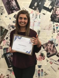 Our student receiving her certificate after completing her Henna Tattoo Course