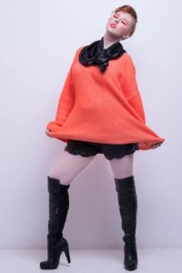 Fashion model in an orange jumper