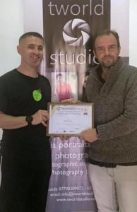 Wedding photography student receiving his certificate of excellence