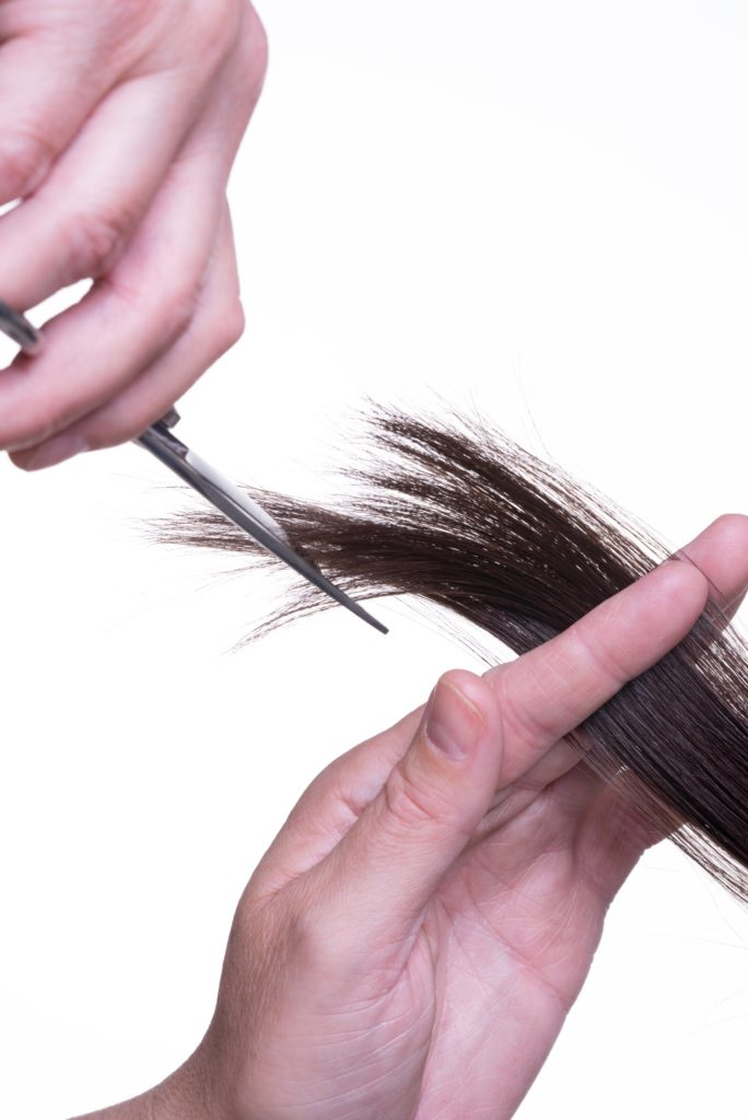 Cutting hair extensions on our hair extension course